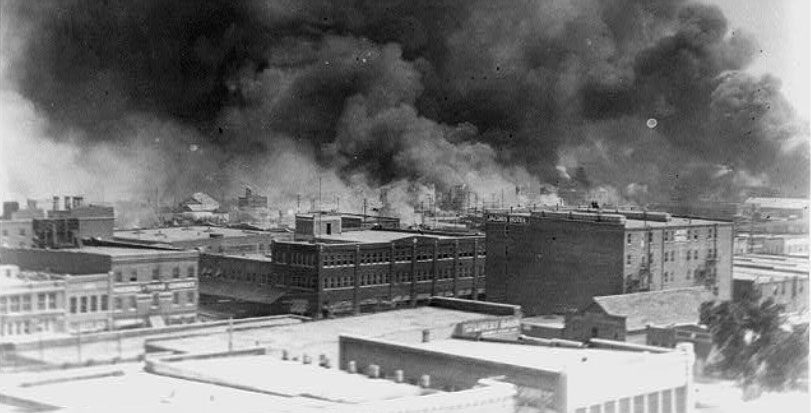 old picture of buildings burning